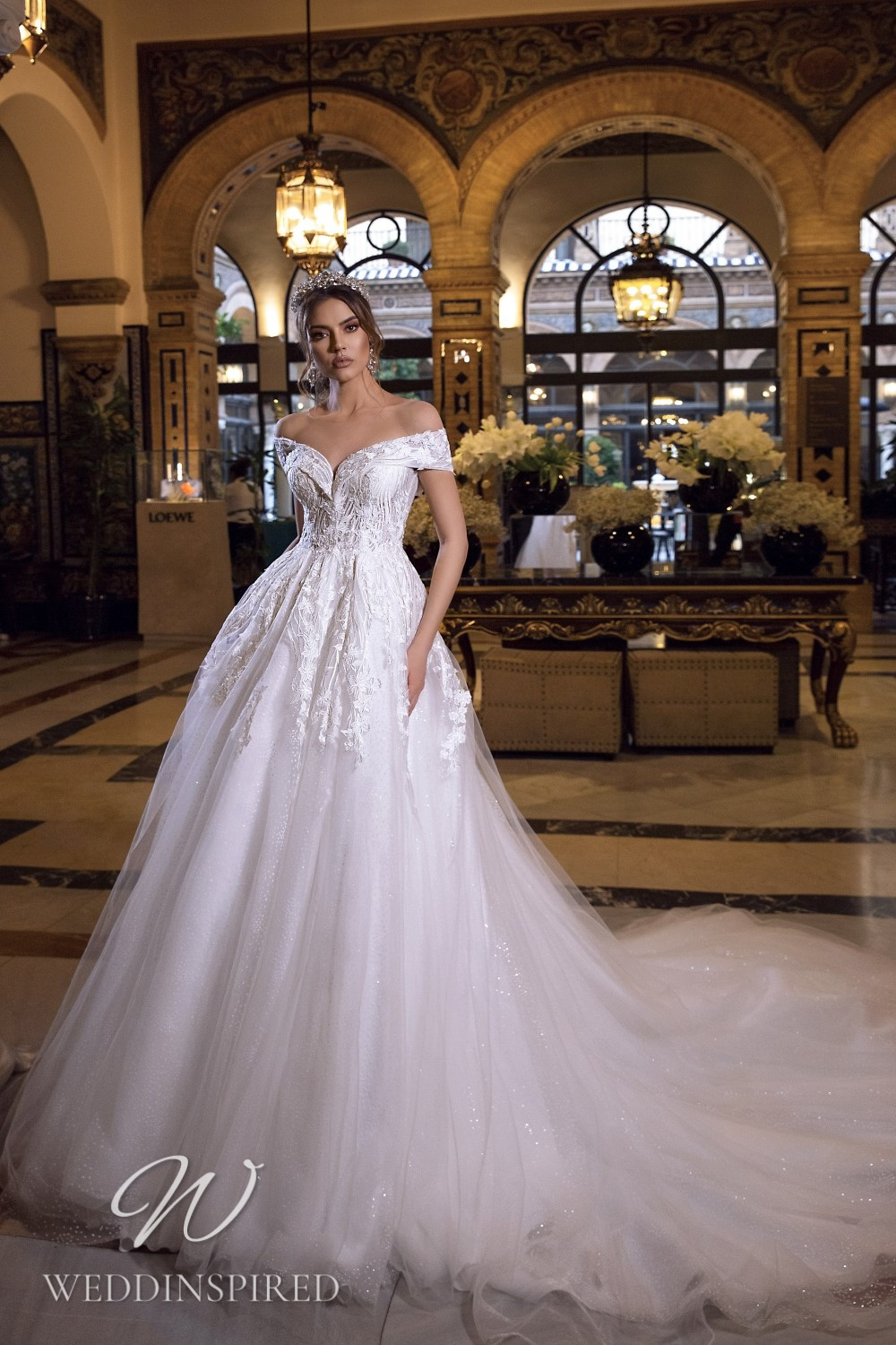 A Maks Mariano off the shoulder tulle and lace princess wedding dress