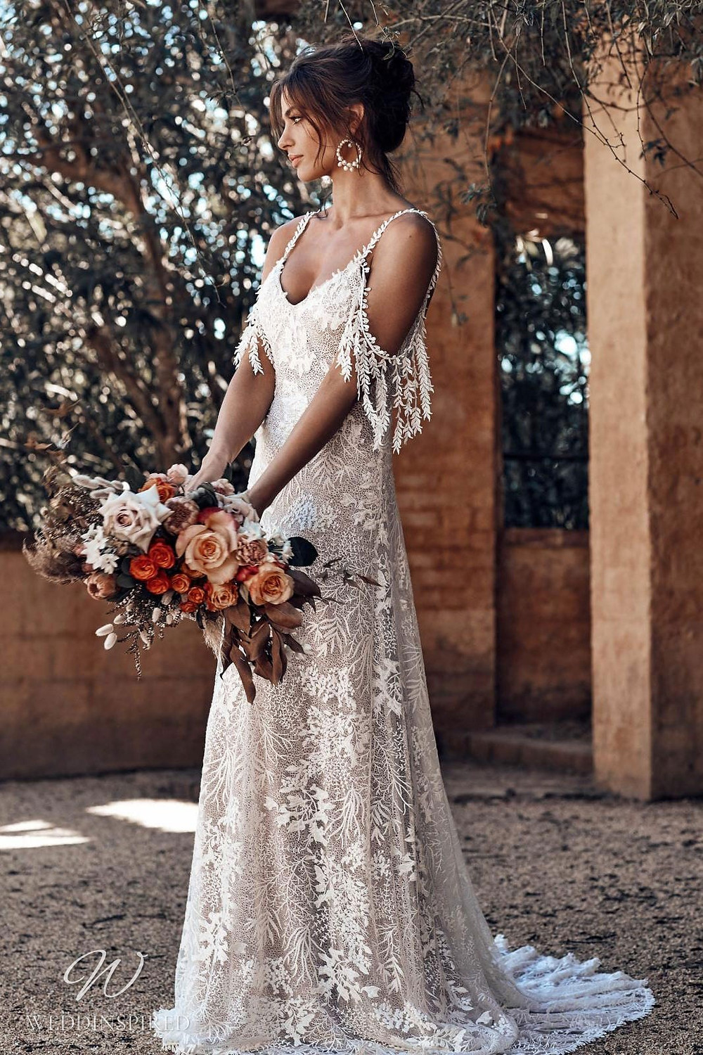 A Grace Loves Lace boho gypsy style off the shoulder lace A-line wedding dress with lace, thin spaghetti straps and leaf detail