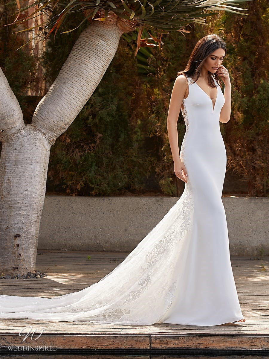 A Pronovias 2021 lace and crepe mermaid wedding dress with straps and a v neckline