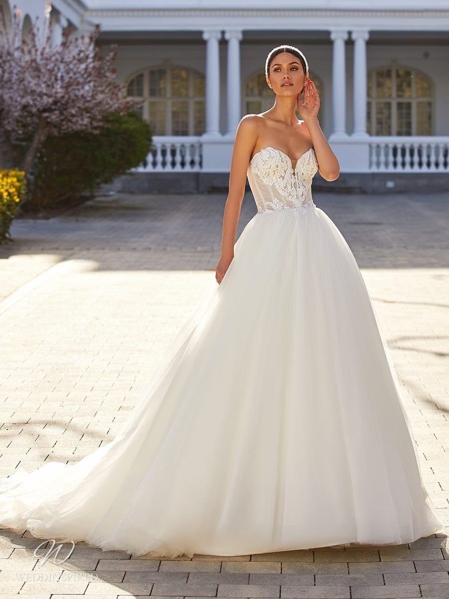 A Pronovias 2021 strapless lace and tulle ball gown wedding dress with a sweetheart neckline