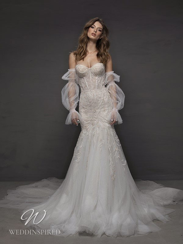 A Riki Dalal 2021 off the shoulder boho tulle mermaid wedding dress with long sleeves