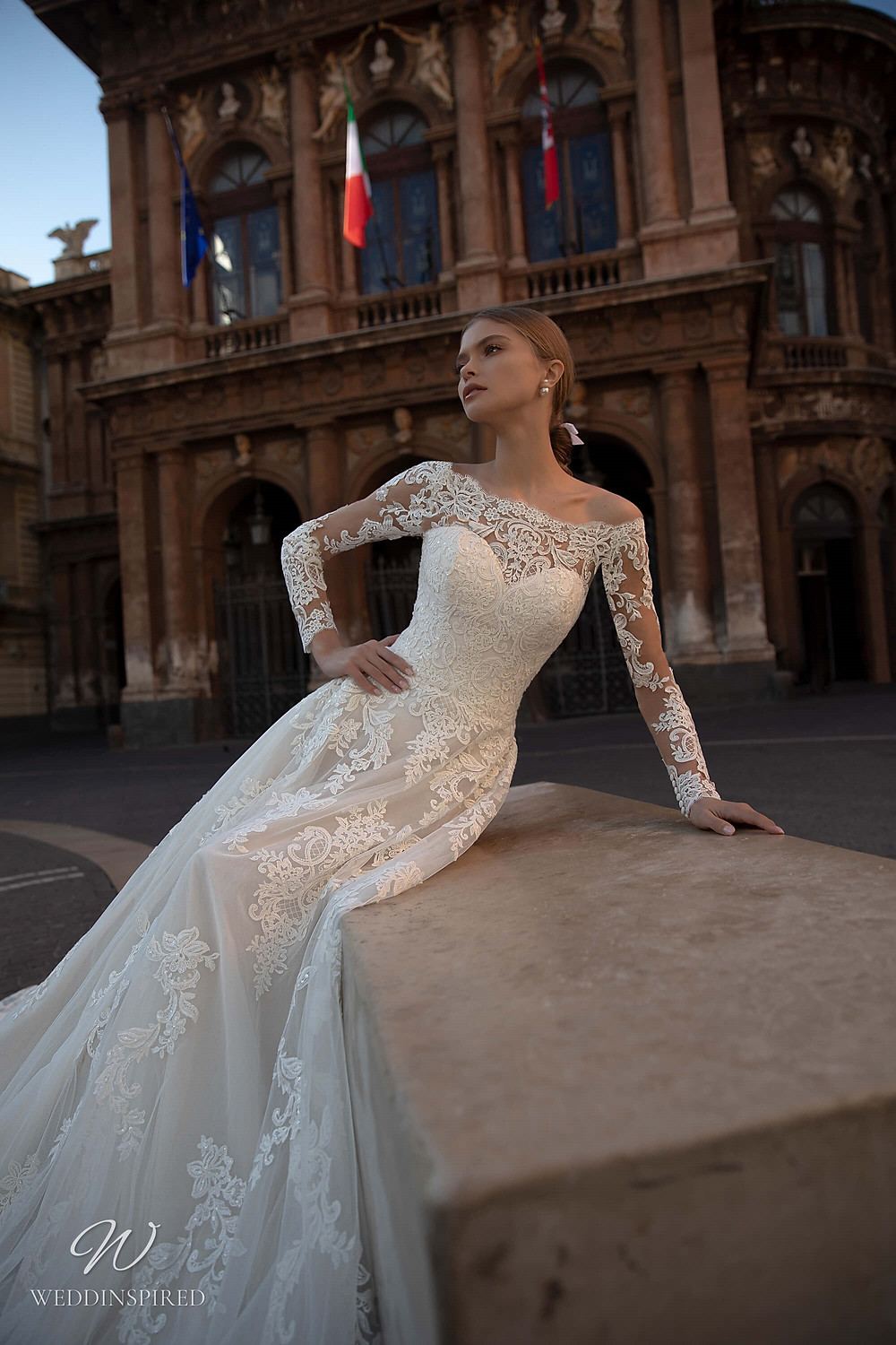 A Naviblue off the shoulder lace A-line wedding dress with long sleeves