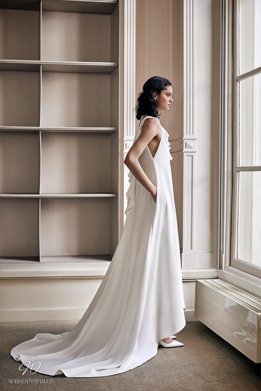 A Viktor & Rolf 2021 loose fitting sheath wedding dress with ruffles