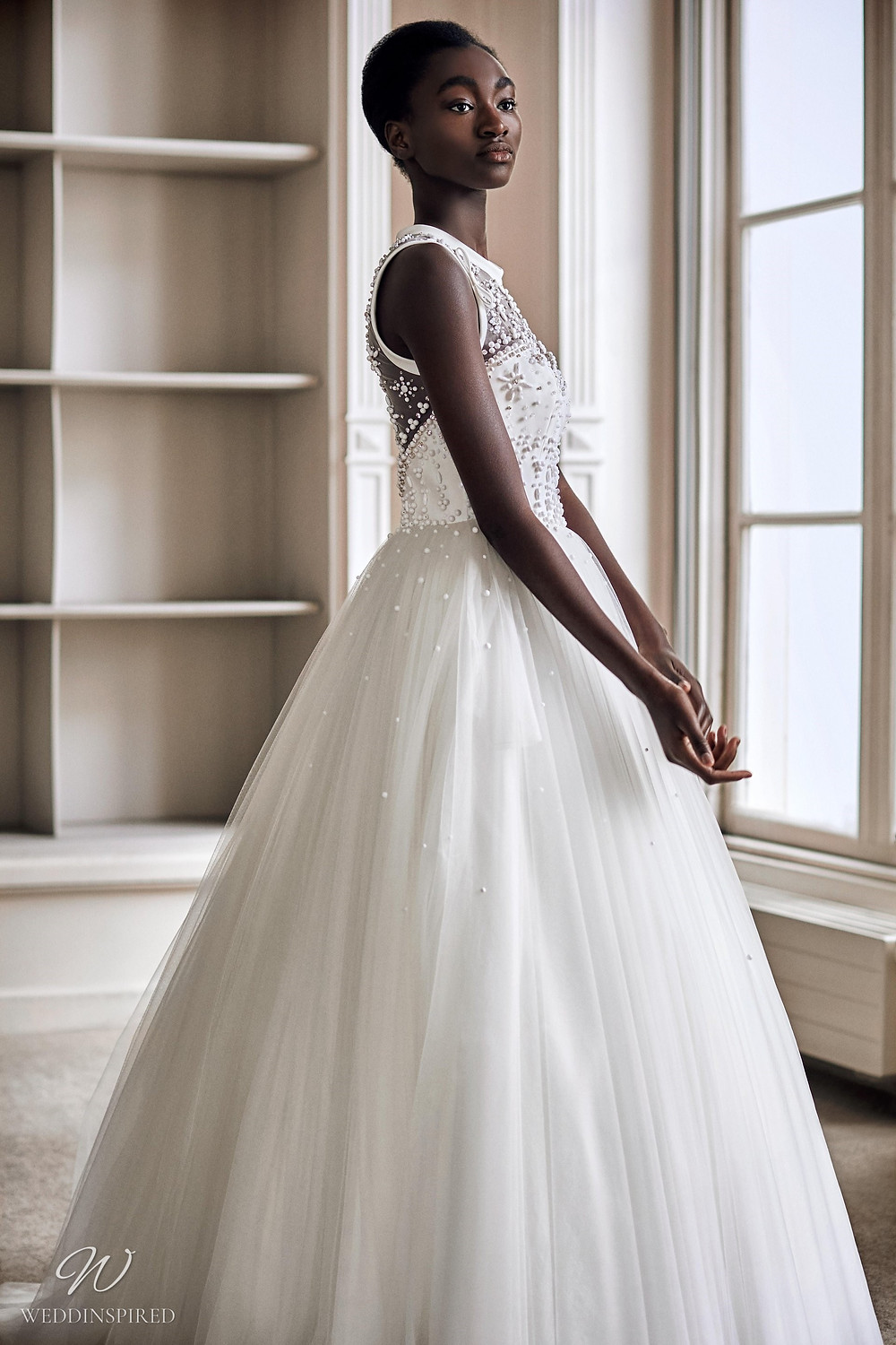 A Viktor & Rolf 2021 princess ball gown wedding dress with a tulle skirt and illusion neckline with beading