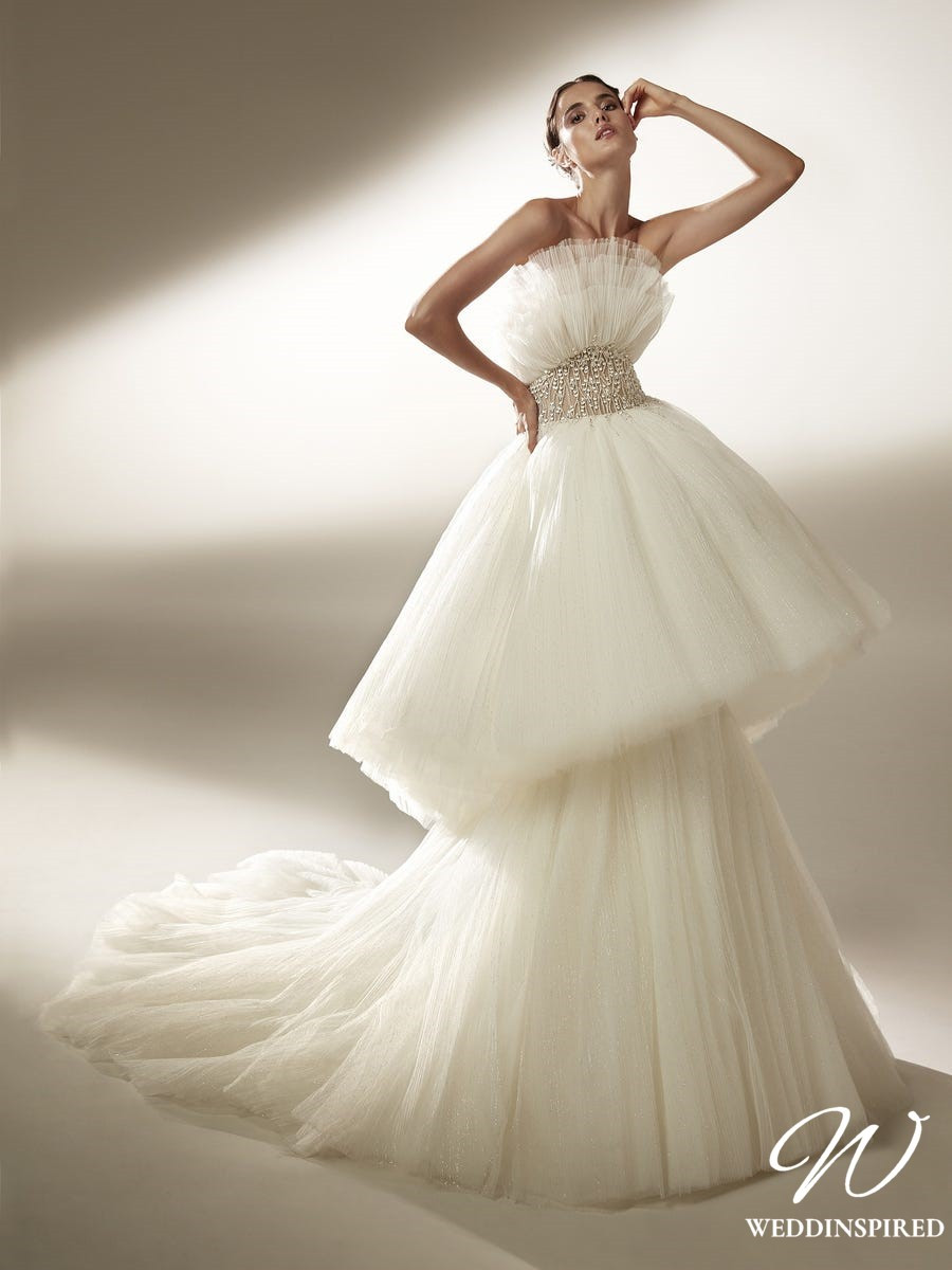 An Atelier Pronovias princess tulle ball gown wedding dress with a layered skirt and beading