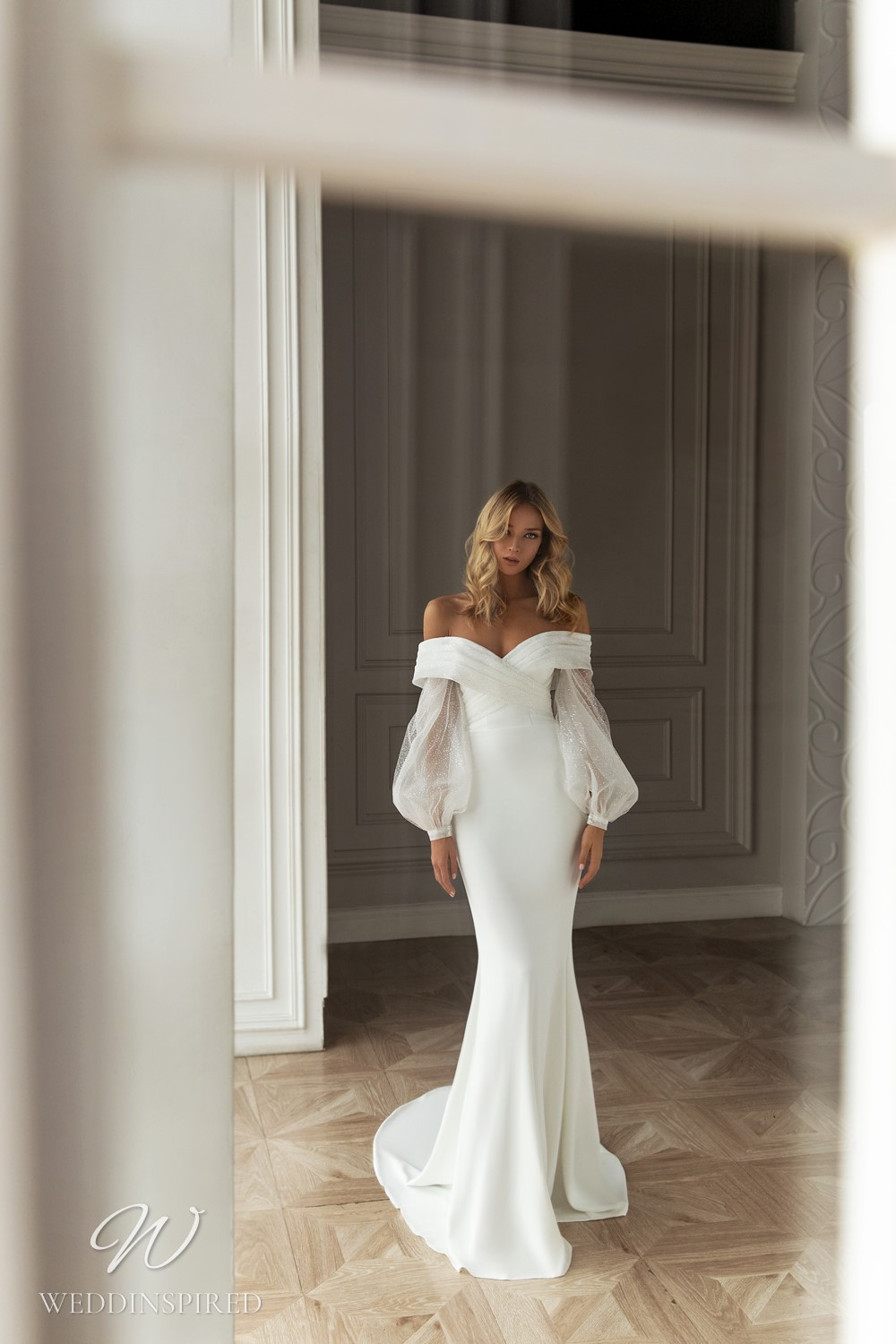 An Eva Lendel 2021 off the shoulder crepe mermaid wedding dress with long balloon sleeves
