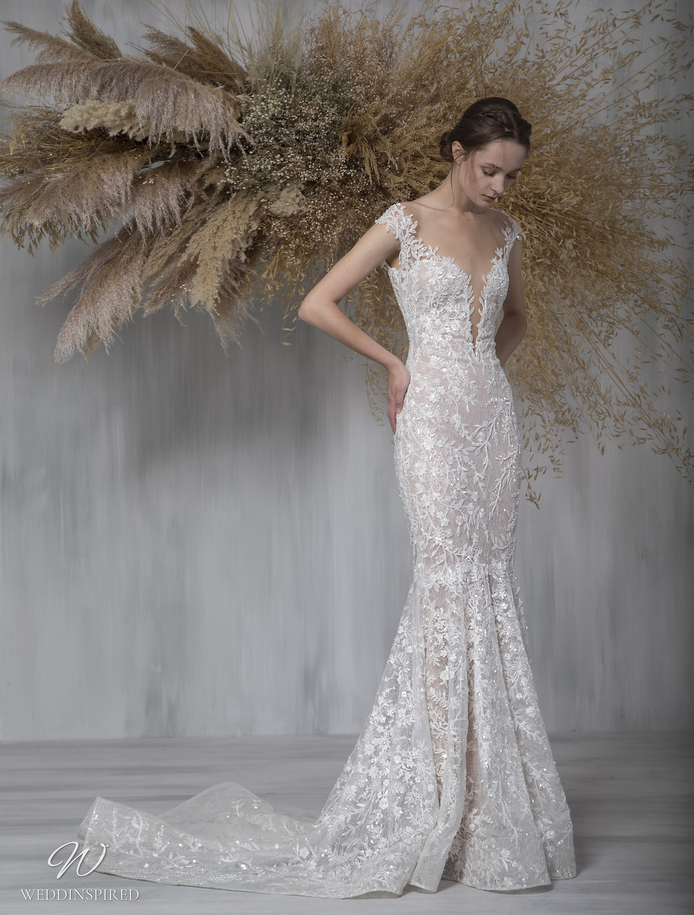 A Tony Ward 2021 off the shoulder lace mermaid wedding dress with a v neck