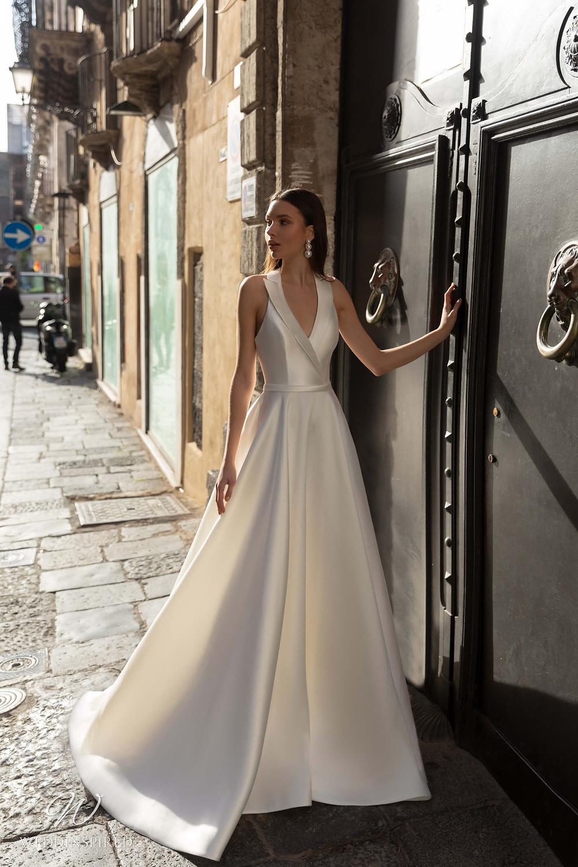 A Naviblue silk satin halterneck A-line wedding dress