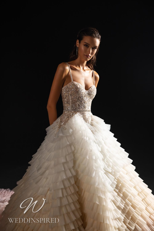 A WONÁ Concept 2021 princess wedding dress with a ruffle skirt