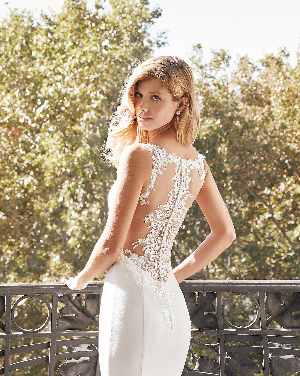 An Aire Barcelona 2020 crepe and lace mermaid wedding dress with an illusion back and buttons