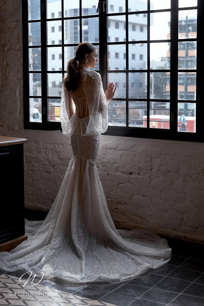 A Julie Vino 2021 strapless sparkle blush lace and tulle mermaid wedding dress with a bustier top