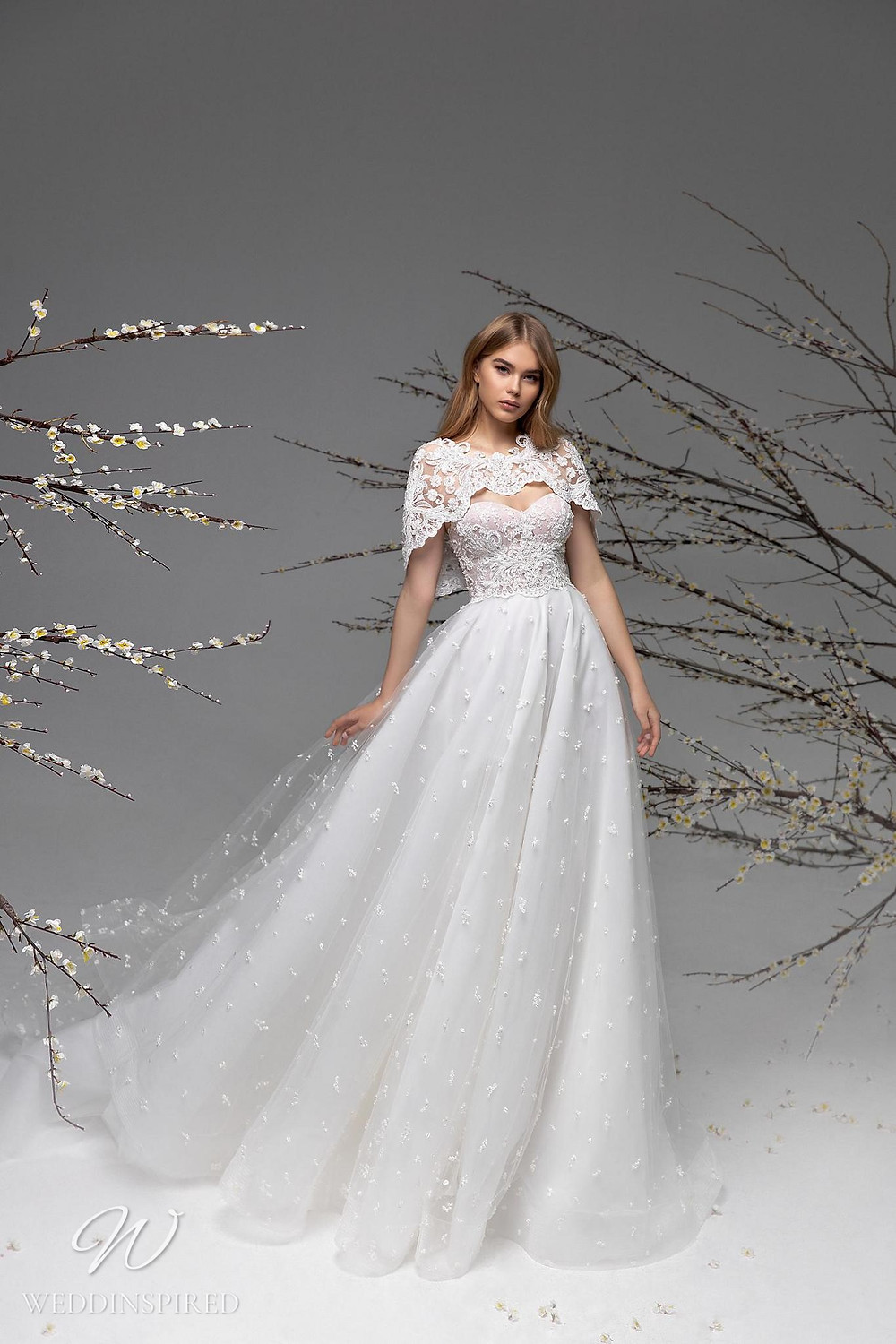 A Ricca Sposa lace and tulle A-line wedding dress with a bolero jacket