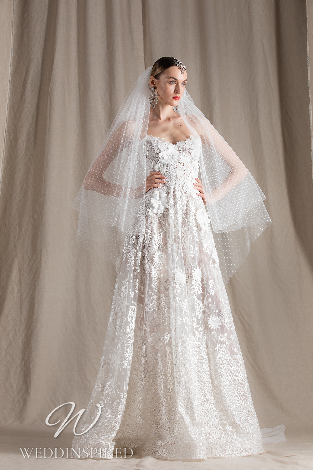 A Naeem Khan 2022 strapless lace and tulle A-line wedding dress