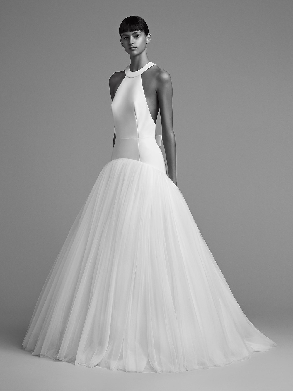 A Viktor & Rolf halterneck tulle drop waist ball gown wedding dress