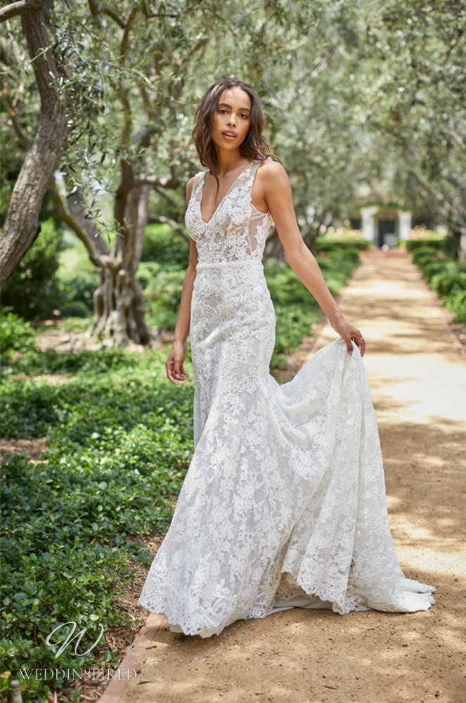 A Monique Lhuillier Bliss Spring 2021 lace mermaid wedding dress with straps, a v neck and a train