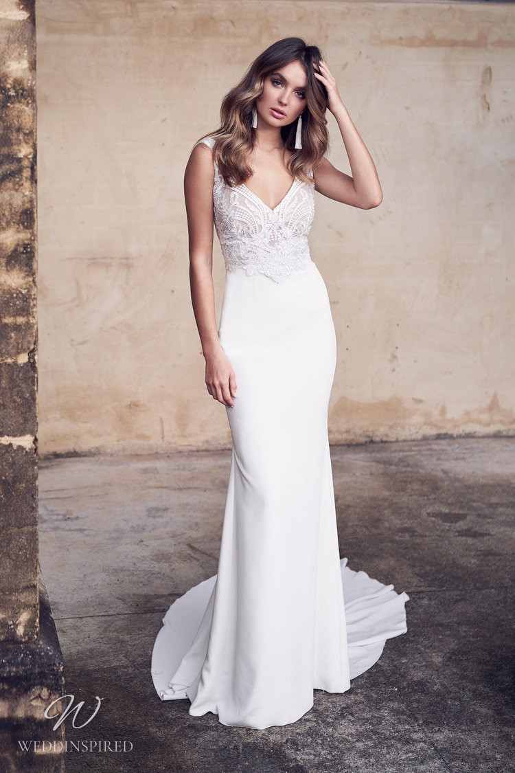 An Anna Campbell 2020 fitted crepe wedding dress with lace and a long train