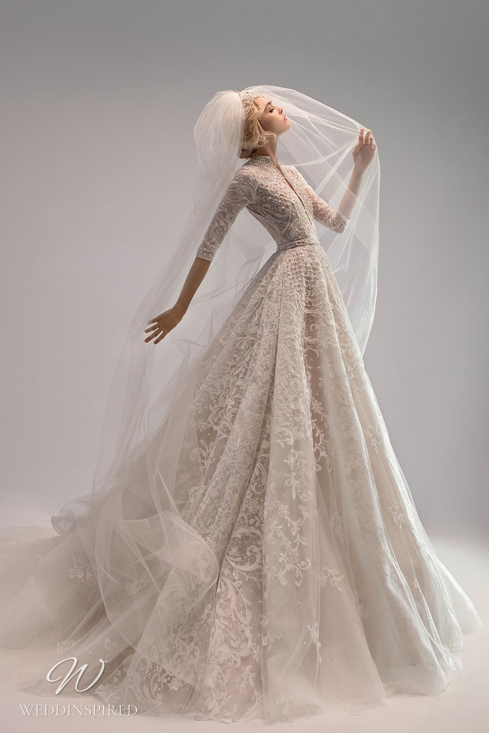 An Ersa Atelier 2021 off white ball gown wedding dress with tulle, lace, half sleeves and beading
