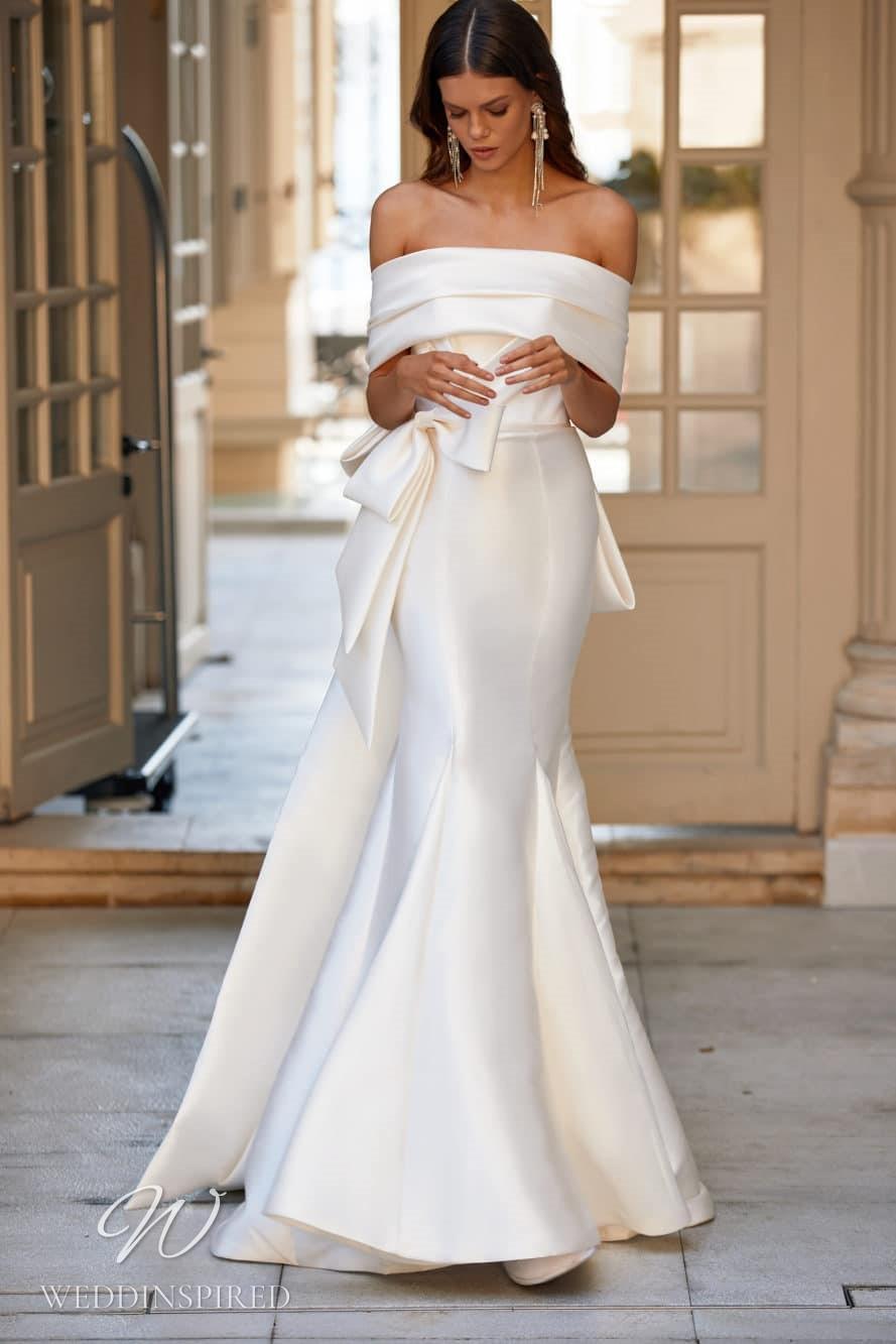 A Milla Nova 2021 simple ivory off the shoulder satin mermaid wedding dress with a train