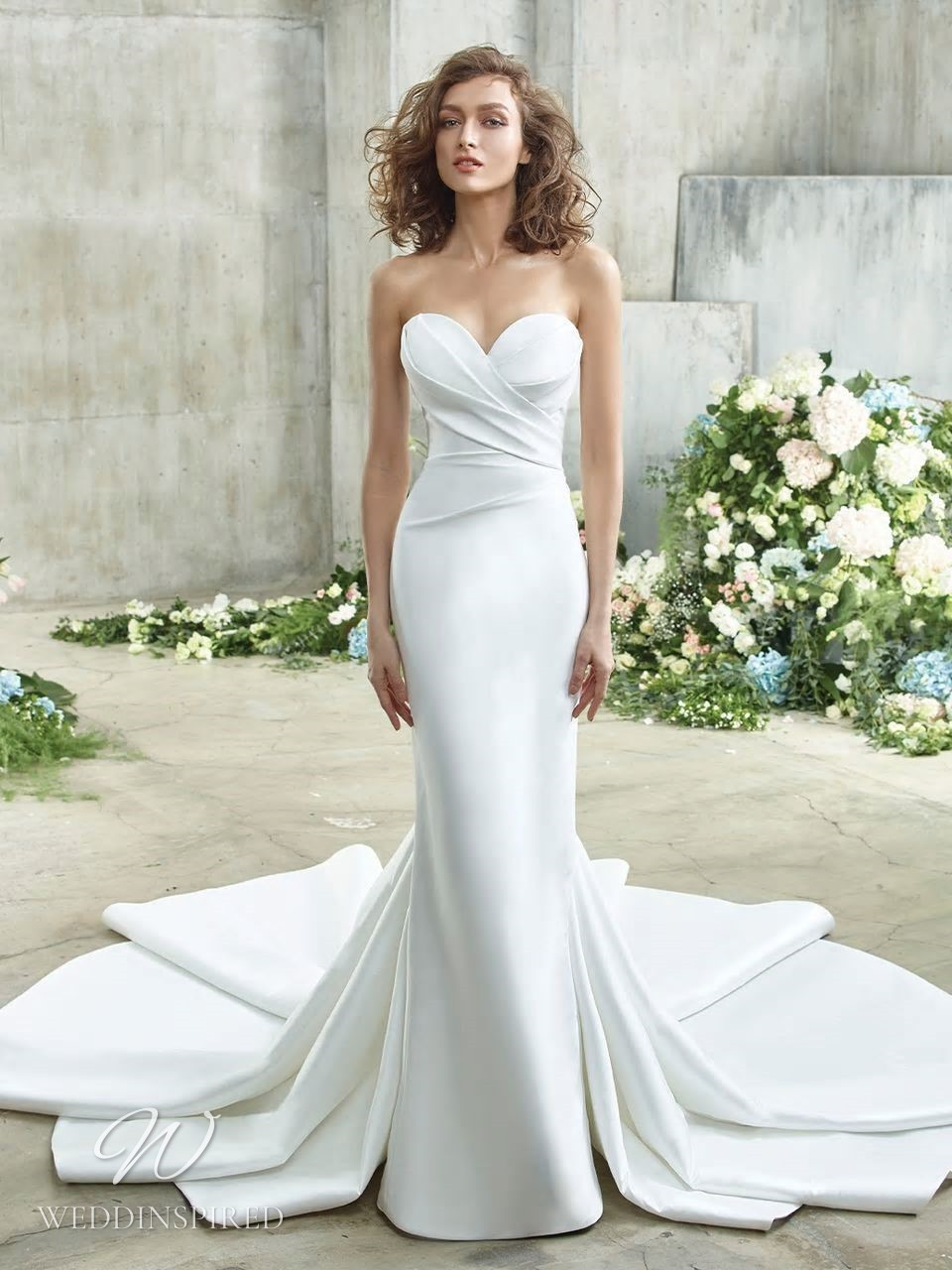 A Badgley Mischka silk column wedding dress with a detachable skirt and a sweetheart neckline