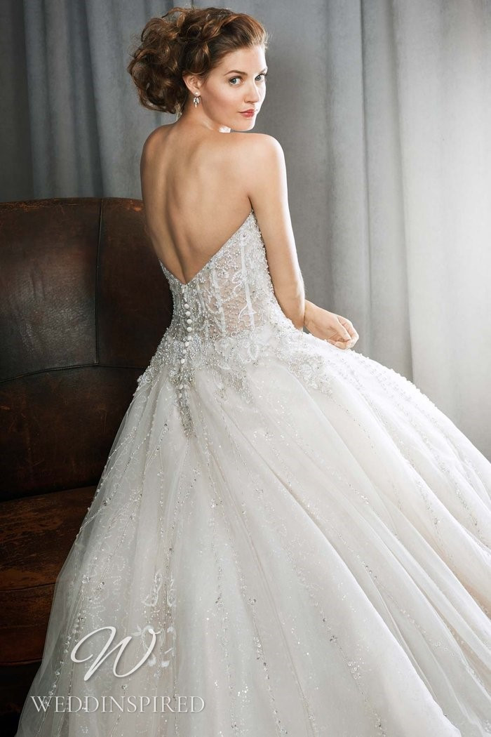 A Kenneth Winston 2021 strapless lace and tulle princess wedding dress with a low back