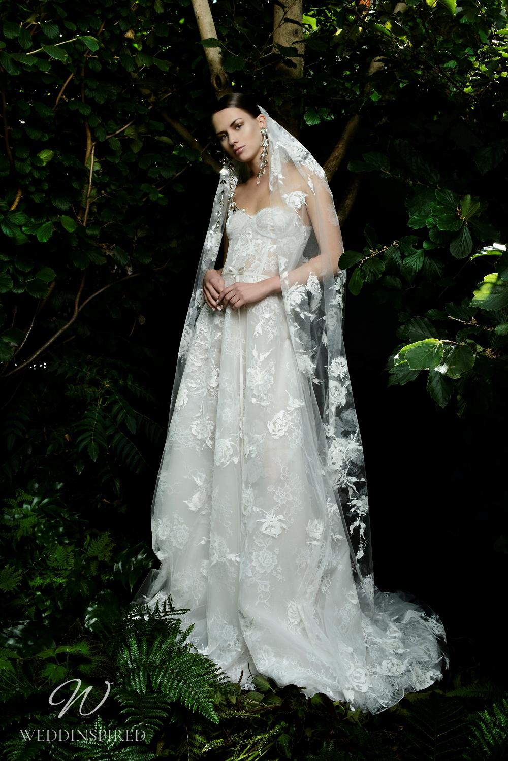 A Naeem Khan Fall 2021 strapless lace A-line wedding dress