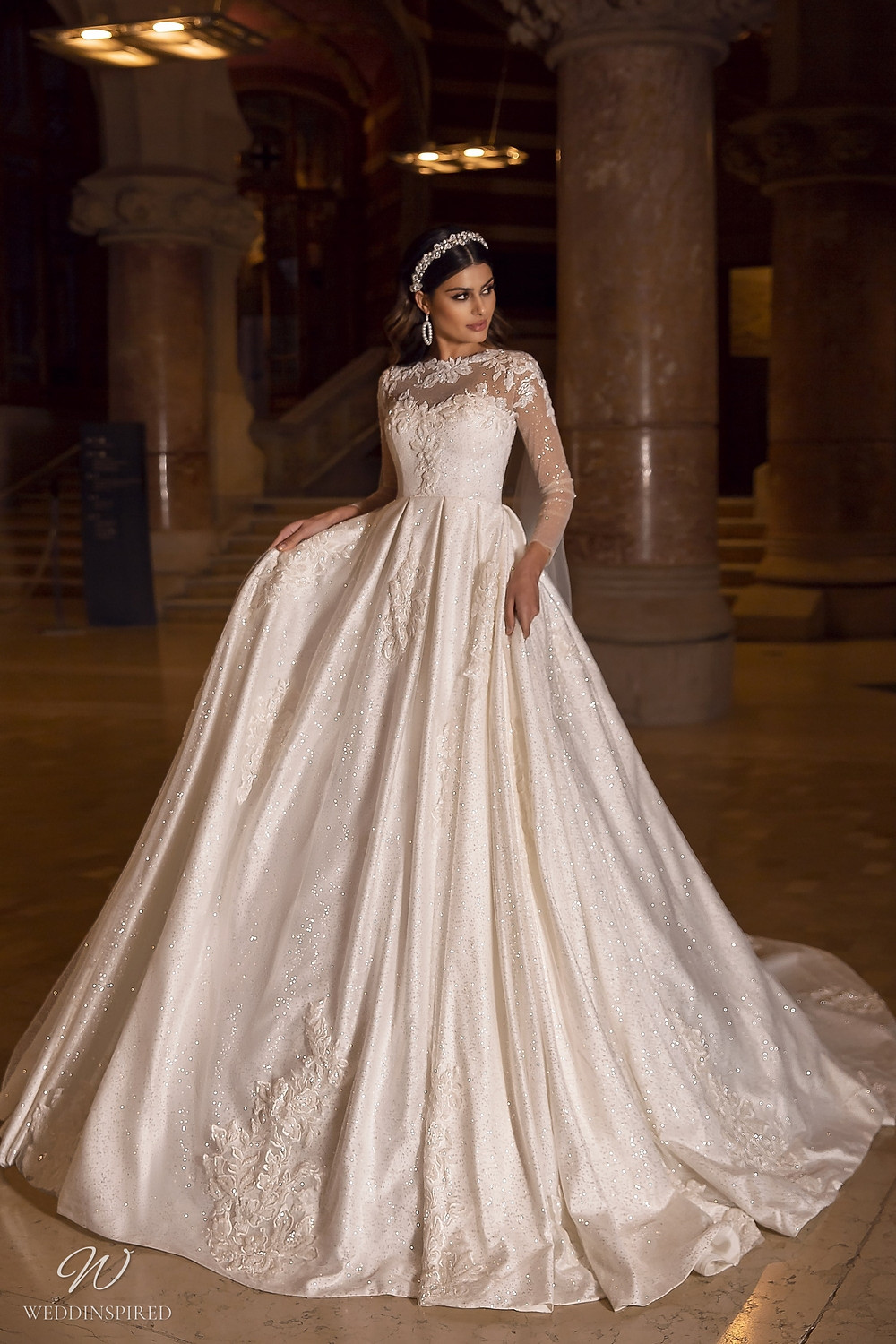 A Maks Mariano champagne sparkle princess ball gown wedding dress with long illusion sleeves