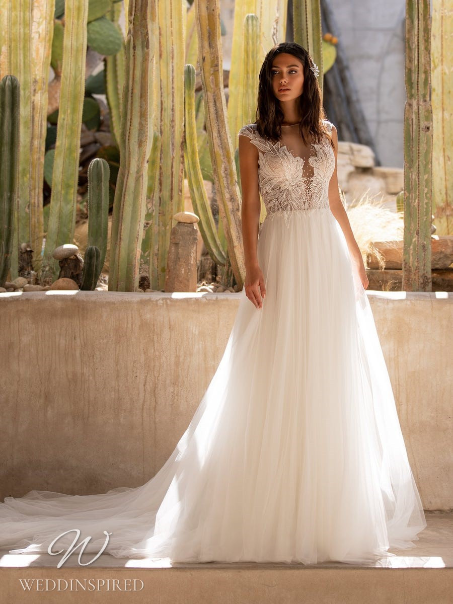A Pronovias 2021 lace and tulle A-line wedding dress with cap sleeves