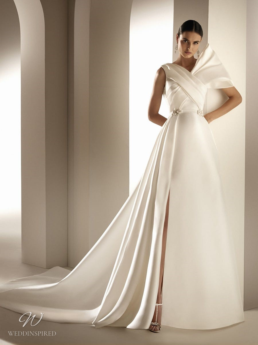 An Atelier Pronovias silk ball gown wedding dress with a high slit and asymmetrical neckline