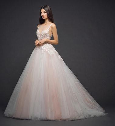 A Lazaro blush pink tulle princess ball gown wedding dress