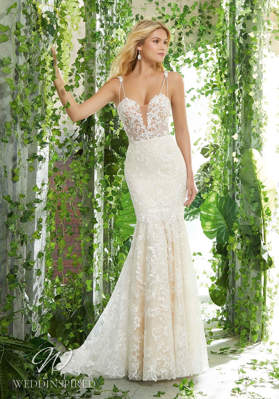 A Madeline Gardner nude lace mermaid wedding dress