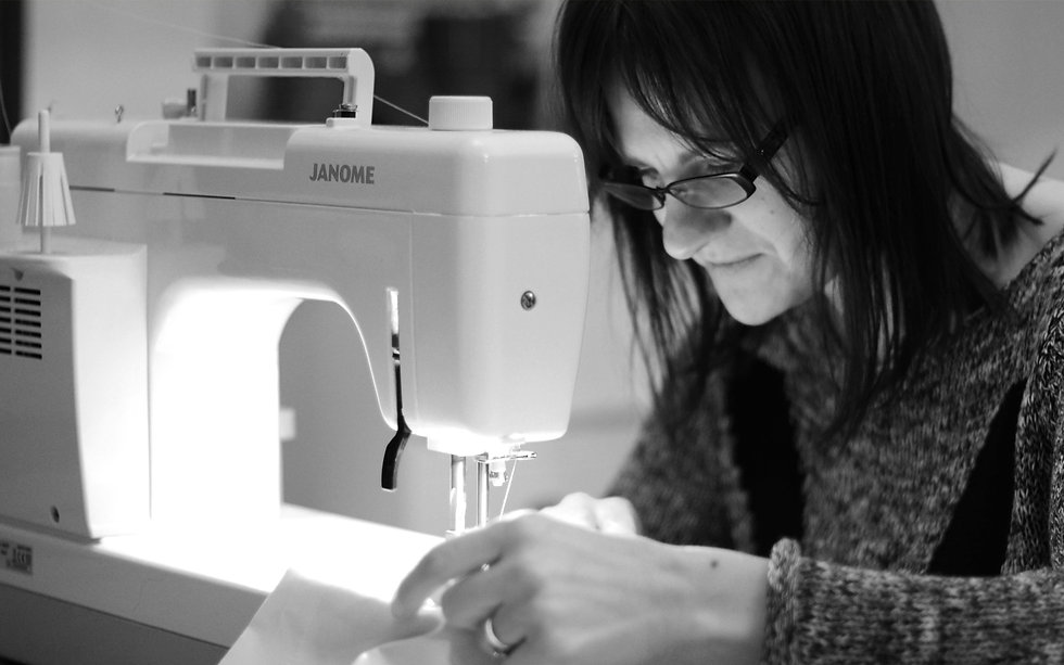 Katie, a curtain maker, joining lining with sewing machine.