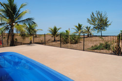 Pool with secure fencing