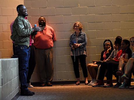 Dallas Cowboy Marquez White pays surprise visit to Middle School