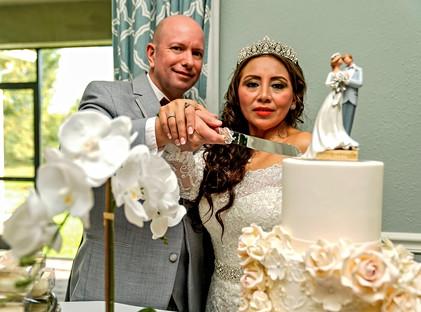 Symoens Cutting Wedding Cake