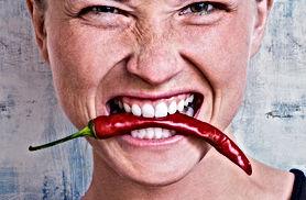 Woman-eating-a-chilli-771081.jpg