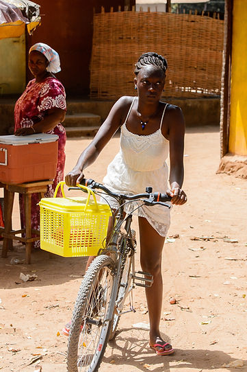 African woman on a bicycle