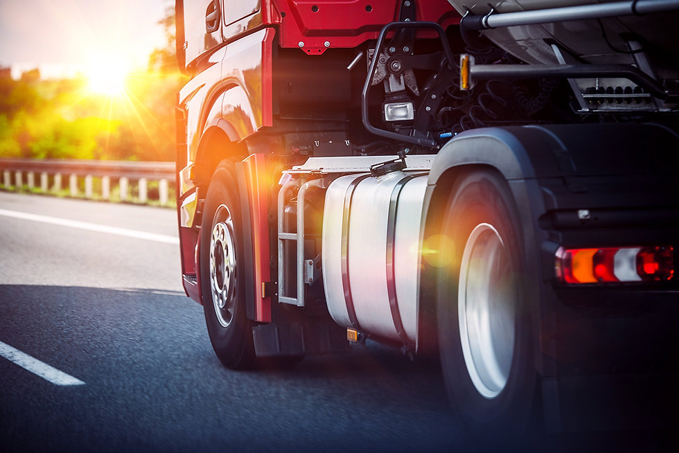Red Semi Truck Speeding on a Highway.jpg