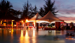Tables and tents at the pool ready for the reception..jpg