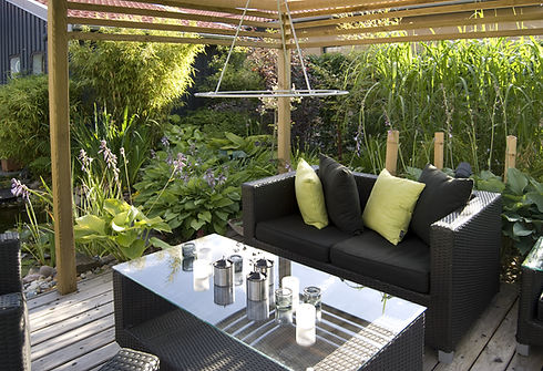 Modern outdoor living, with wicker sofas and table..jpg