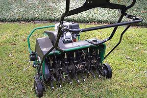 Closeup of a lawn aeration machine on Florida grass.jpg