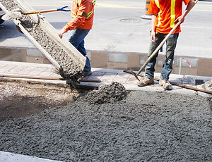 Pouring cement during sidewalk upgrade.jpg
