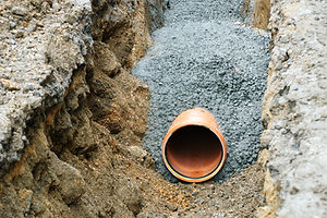 Plastic pipes buried, covered with concrete.jpg