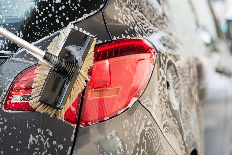 Washing a car with scrub brush.jpg