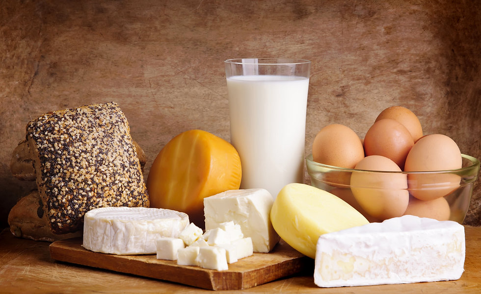 Still life with dairy products on a vintage wooden background.jpg