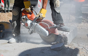 Low section of male worker cutting concrete block.jpg