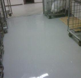Polyaspatic spray warehouse floor.jpg