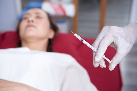 Woman receiving stem cell therapy