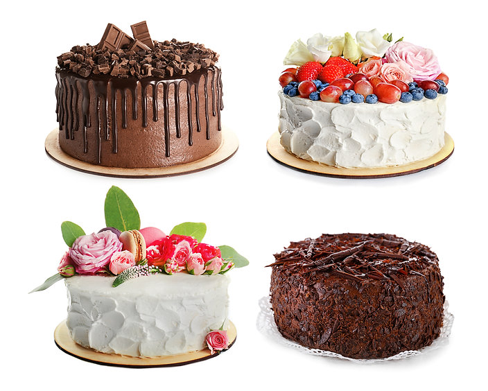 Set of different delicious cakes on whit