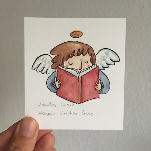 tiny Angel reading a book