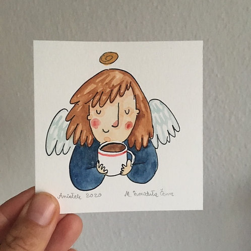 Angel with a cup of cocoa